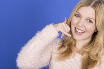 Model Released. Attractive Young Woman Making a Telephone Call