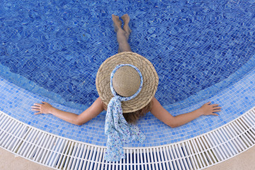 woman relaxing in an outdoor waterpool