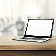 Laptop with blank screen on wood table and blurred background