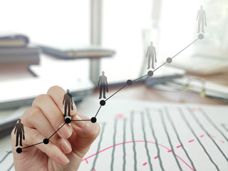 hand working with new modern computer and business strategy as c