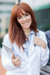 portrait of smiling female doctor standing outside with tablet p