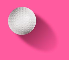 Golf ball on pink