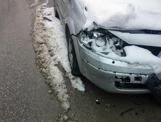 car crash in winter. damaged vehicle after crash