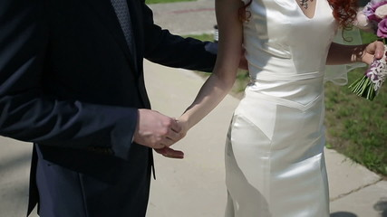 Just married couple walking. Slow motion