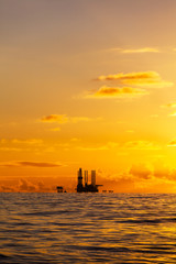 Oil platform on the North Sea at sunset. Vertical