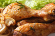 Fried chicken legs with mushrooms and lettuce macro. horizontal