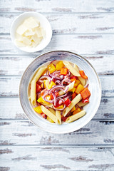 Penne with yellow and red pepper