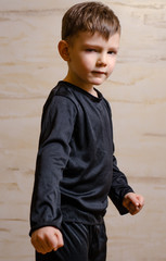 Portrait of Strong Male Kid in Black Attire