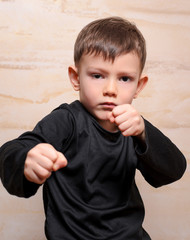 Serious Fighter Kid Posing with Closed Fists