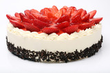 Cream cake with strawberries on white background