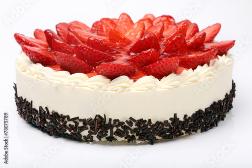 Fototapeta Cream cake with strawberries on white background
