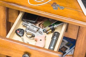 Handgun in nightstand drawer