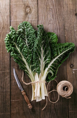 Bunch of silverbeet on a rustic wooden background