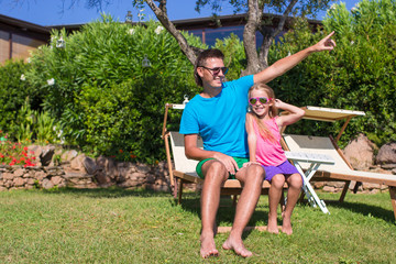 Father and daughter at tropical vacation having fun outdoor