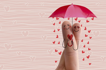 Finger art. Lovers is embracing and holding red umbrella