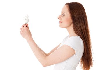 Young woman with energy efficient  lightbulb.