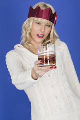 Attractive Young Woman Holding a Glass of Whiskey