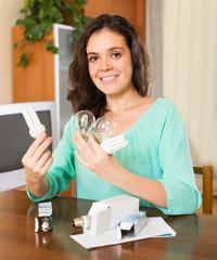 Woman holding lightbulbs