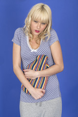 Attractive Young Woman Holding a Hot Water Bottle