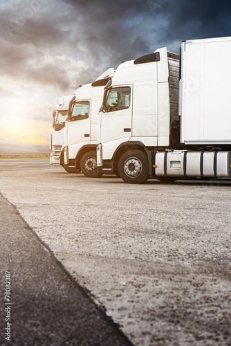 Three white trucks in a row - 78082387