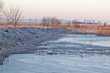 Frosty morning landscape with lake
