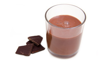 Glass with cocoa drink on white background