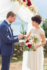 groom wears a wedding ring
