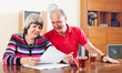 mature couple looking financial  in home