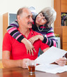 Loving mature  couple with financial documents