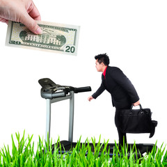 Human hand putting money chase businessman working, metaphor