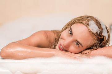 closeup of beautiful blond young woman having a bubble bath