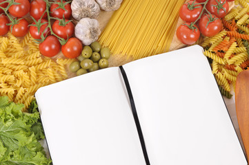 Pasta with blank recipe book and chopping board