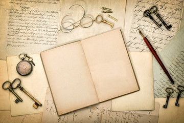 Open diary book, old letters and postcards. Paper texture