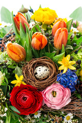 easter bouquet with egg decoration. spring flowers tulip, ranunc