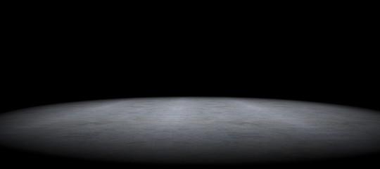 Cement floor background and spot light.Between darkness