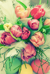 Tulip flowers and easter eggs. Floral arrangement