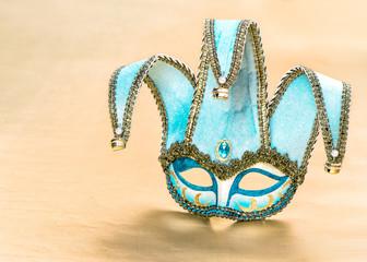 Venetian carnival mask over golden background