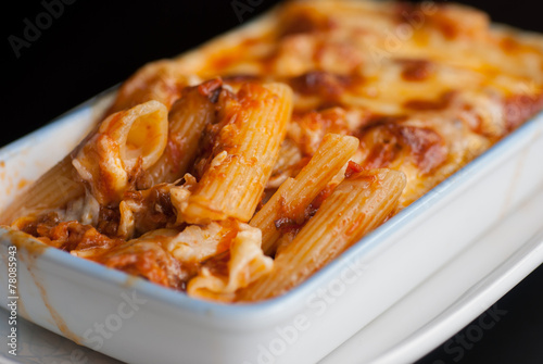 Leinwanddruck Bild Baked penne pasta with tomato sauce and cheese