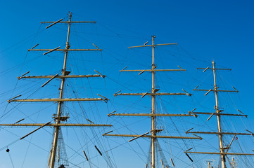 Mast of a ship on a background of blue sky.