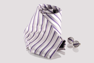 tie with cuff links on white background