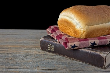 bread loaf on Holy Bible