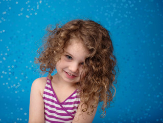 Happy Smiling Laughing Child: Blue Background Icy Frozen Snowfla
