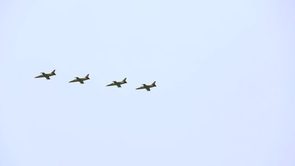 Group of four educational training aircrafts L39 flying in the
