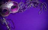 Fototapety Purple Mardi-Gras or Venetian mask on purple background