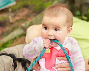 Baby girl eating climbing rope