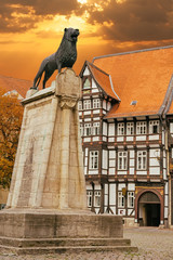 Lion statue and old timbered house in Braunschweig