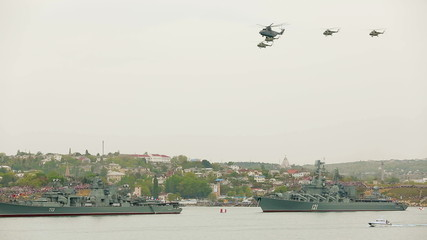Helicopters  flying in the sky during military parade Russian