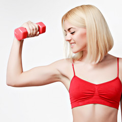 girl with a sports figure does exercises with dumbbell