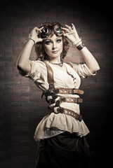Steampunk girl with goggles. Old-fashioned.