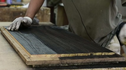 Carpenter polish burned wood planks